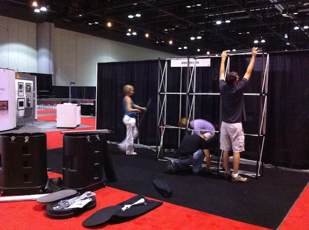 The team at Artistic Photo Canvas begins booth setup at Photoshop World in Orlando