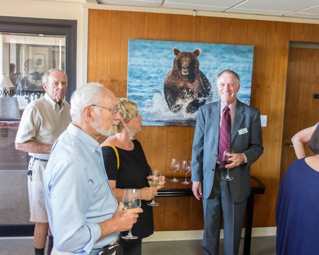 Nature photographer Lou Newman greets guests at a recent exhibition of his work.